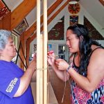 Marae carving Kelly Dixon and Donna Paora working on the final tukutuku panel during a workshop this past summer