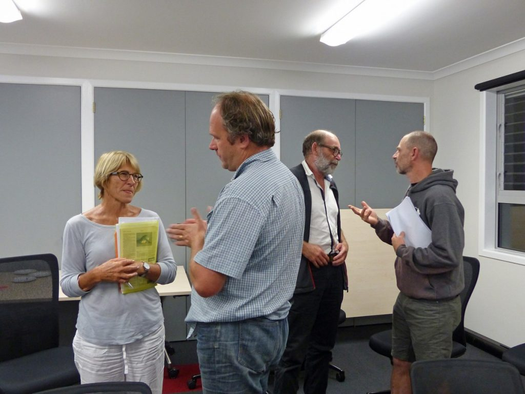 Tensions were visible as marine reserve supporters and opponents chatted after last Wednesday's meeting. Above – Keep Our Beaches spokesperson Deb Cox with Waiheke Local Board chairperson Paul Walden and Friends of the Hauraki Gulf spokesperson Alex Stone with fly fishing business operator Matt von Sturmer.