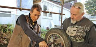 rolley Derby Sam Message and Neil Hemens bolt the axel to their trolley's frame