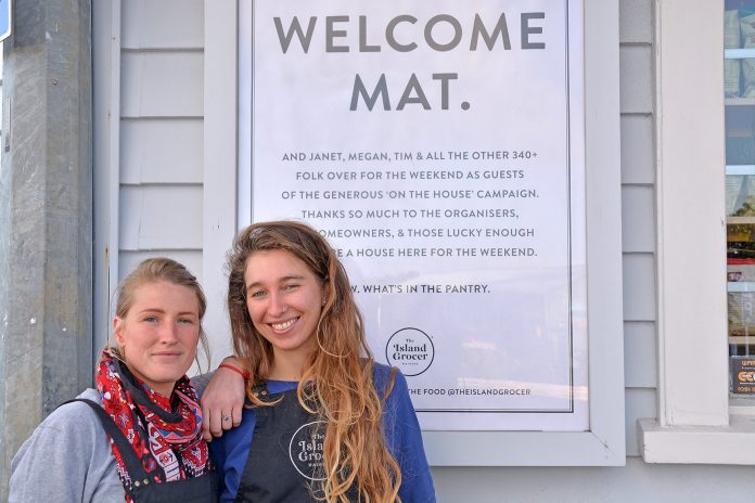 The Island Grocer crew including Manon and Victoria (pictured) came out in support of On The House last weekend putting up this poster welcoming visitors to the island. Owners Nicky and Simon Cairns say they noticed a lot of positivity from curious visitors and they felt a slightly festive atmosphere in Oneroa village. Photo Sophie Boladeras