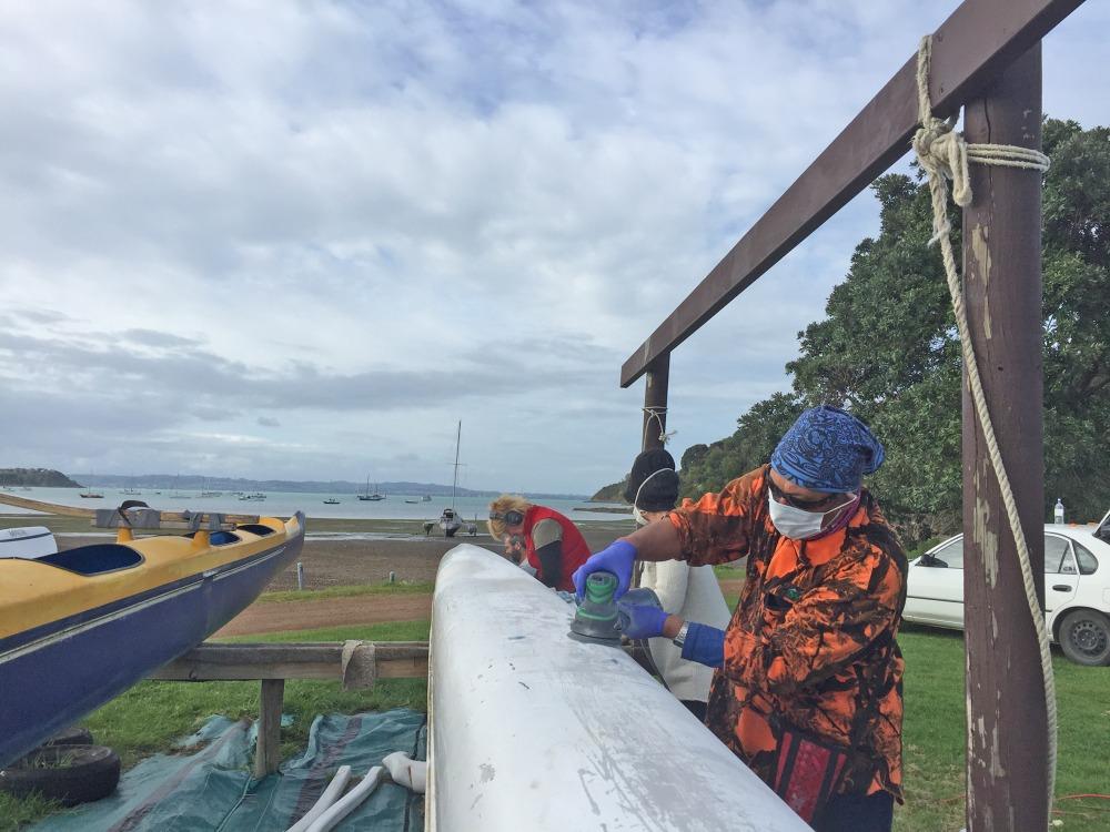 Noema Cash sanding the waka ama Photo Lorraine Dawson
